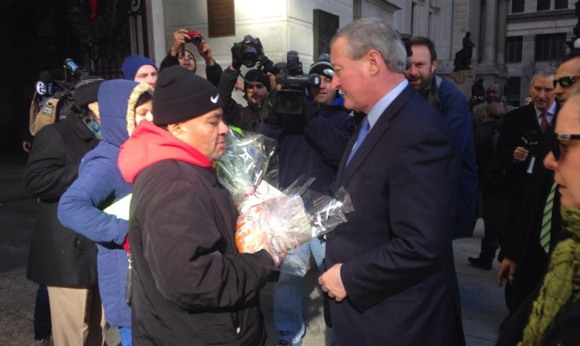Hand-delivering bread made by undocumented workers on Kenney's first day as mayor
